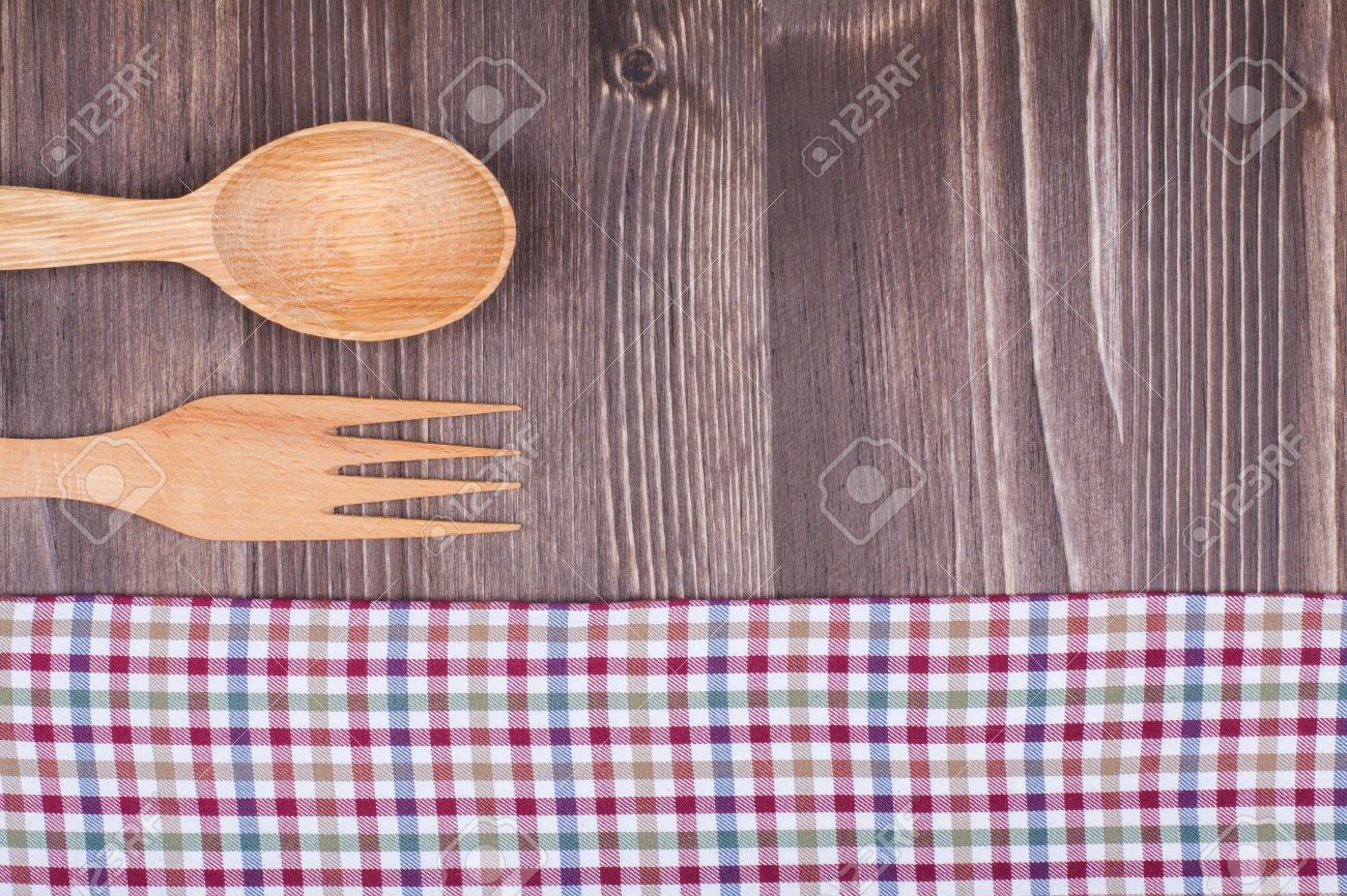 Beau Kitchen Tablecloth, Wooden Spoon, Fork On Table Background Stock Photo    19742175