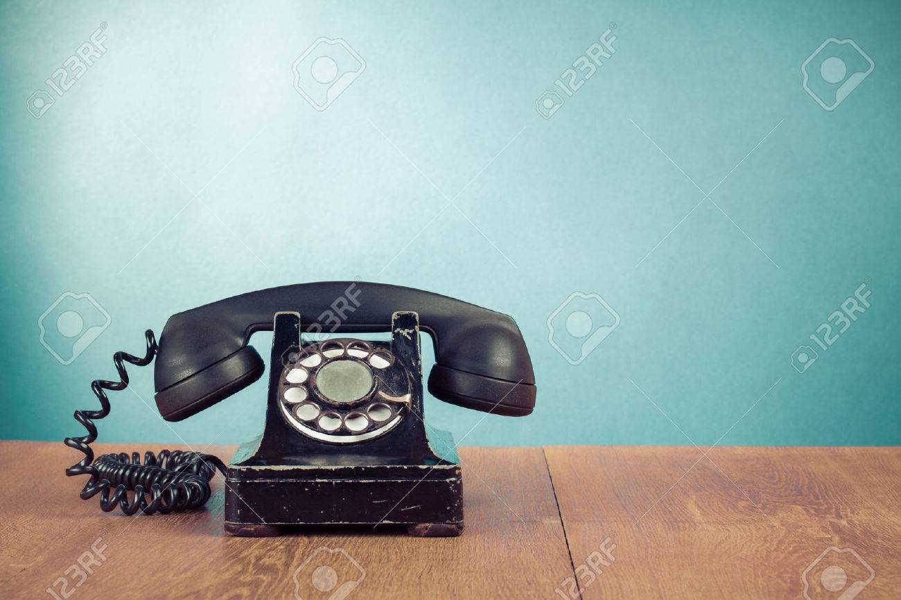 Retro telephone on table in front mint green background Stock Photo - 23020513