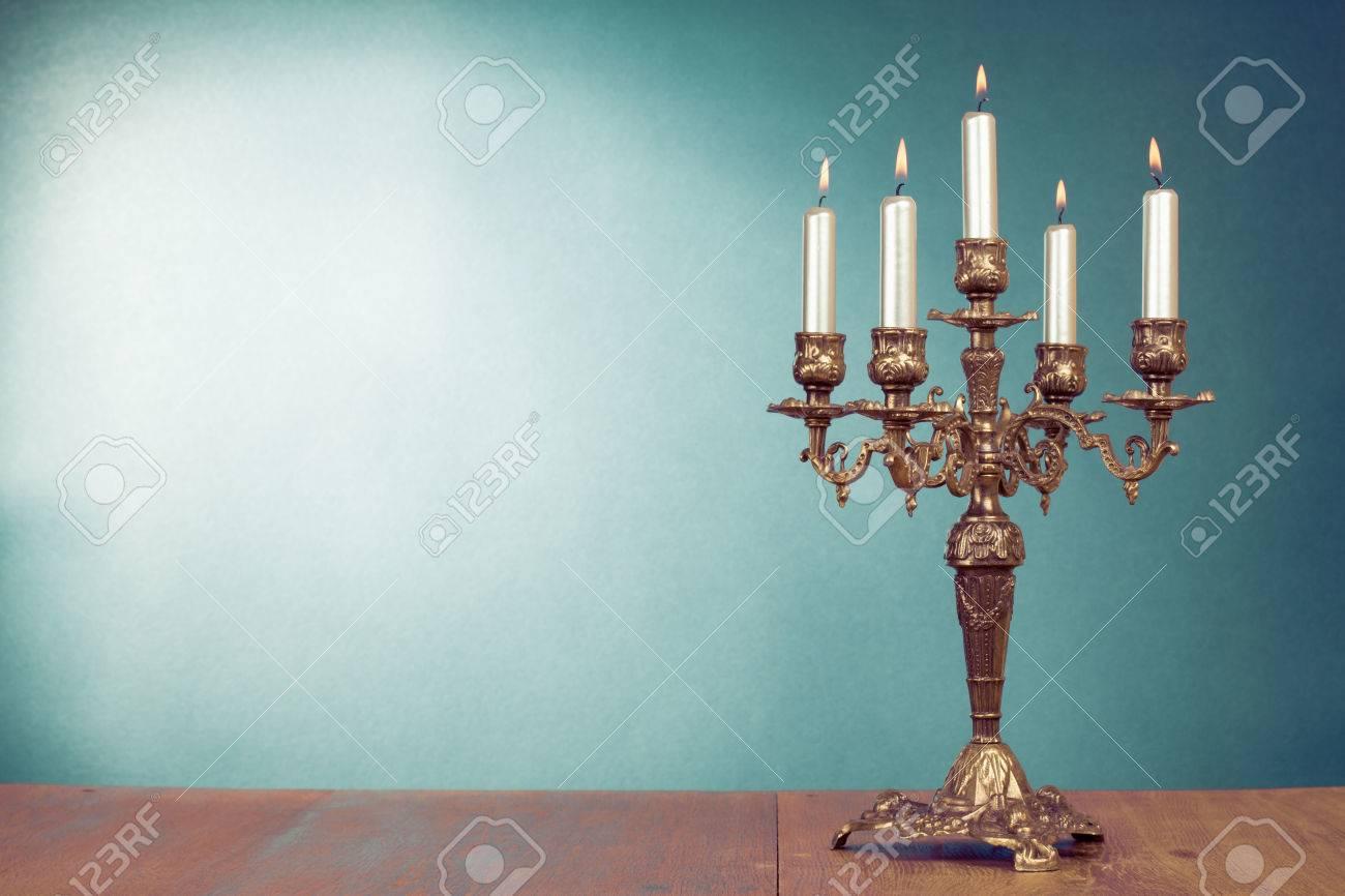Burning old candle vintage bronze candlestick. Isolated On White ...