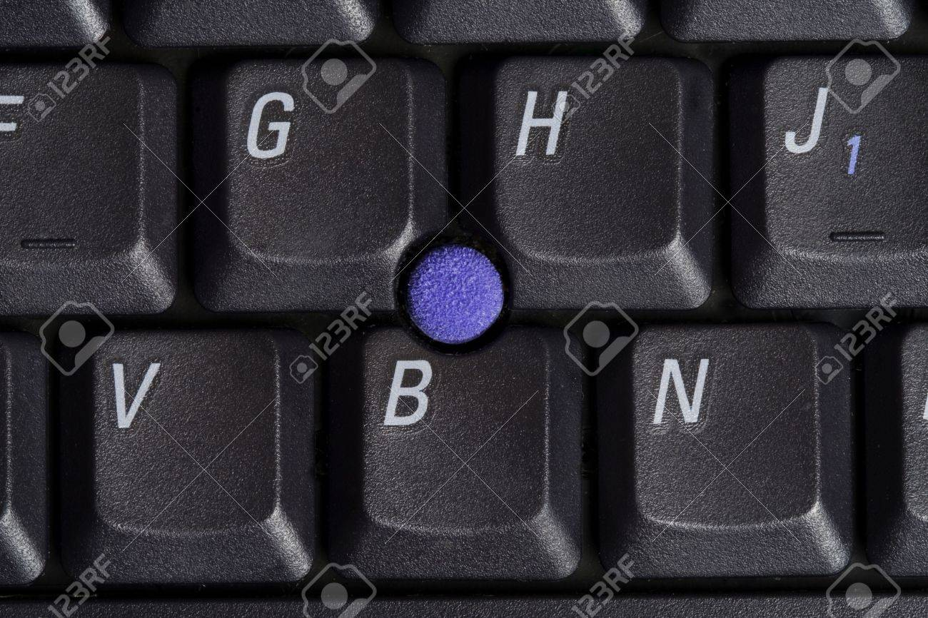 Macro shot of laptop keyboard with point stick surrounded by