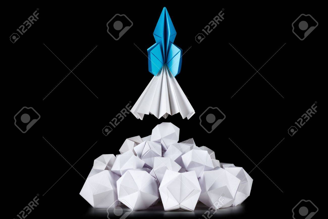 Concept of successful business or strategy, e.g. for app development or business startups. The rocket launch in white cloud of smoke - 44613709