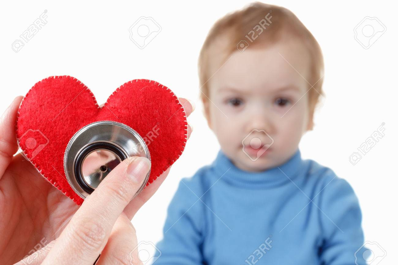 Concept of health and care. Baby and cardiologist, heart symbol in hand and stethoscope. - 51521959