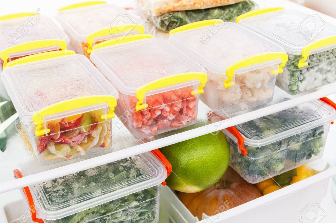 Frozen food in the refrigerator. Vegetables on the freezer shelves. Stocks of meal for the winter. - 66063253