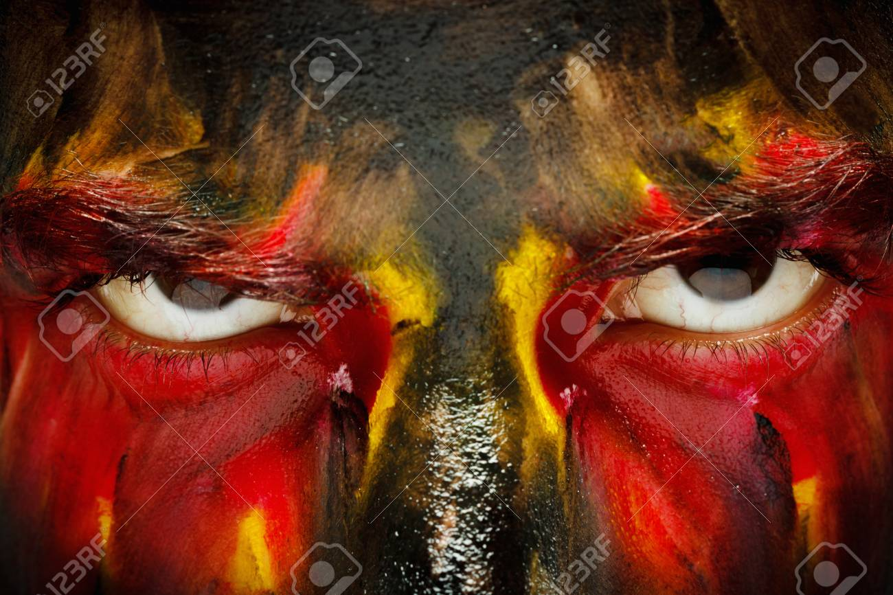 German or belgian sports fan patriot. Painted colors country flag on angry man face. Devil savage Eyes close up - 88277807