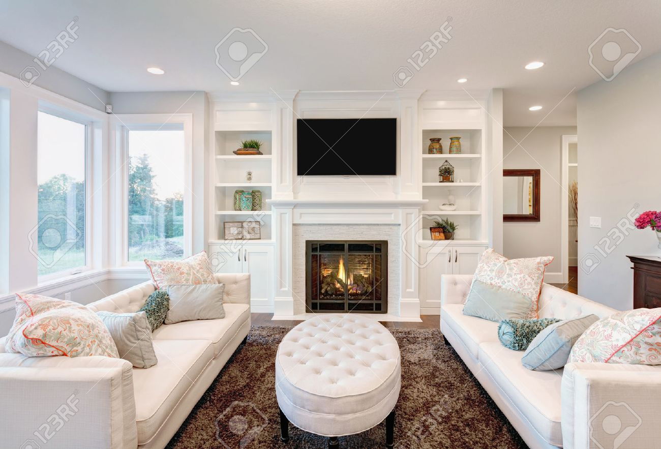 123RF.com & Beautiful Living Room with Fireplace in New Luxury Home