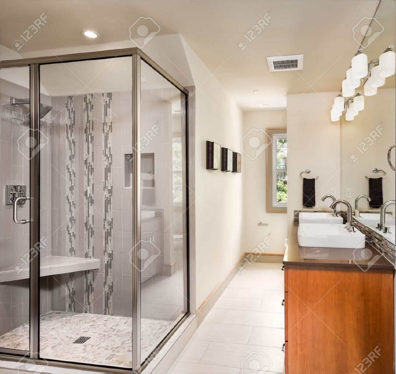 Bathroom interior in luxury home with two sinks tile floor and shower stock photo