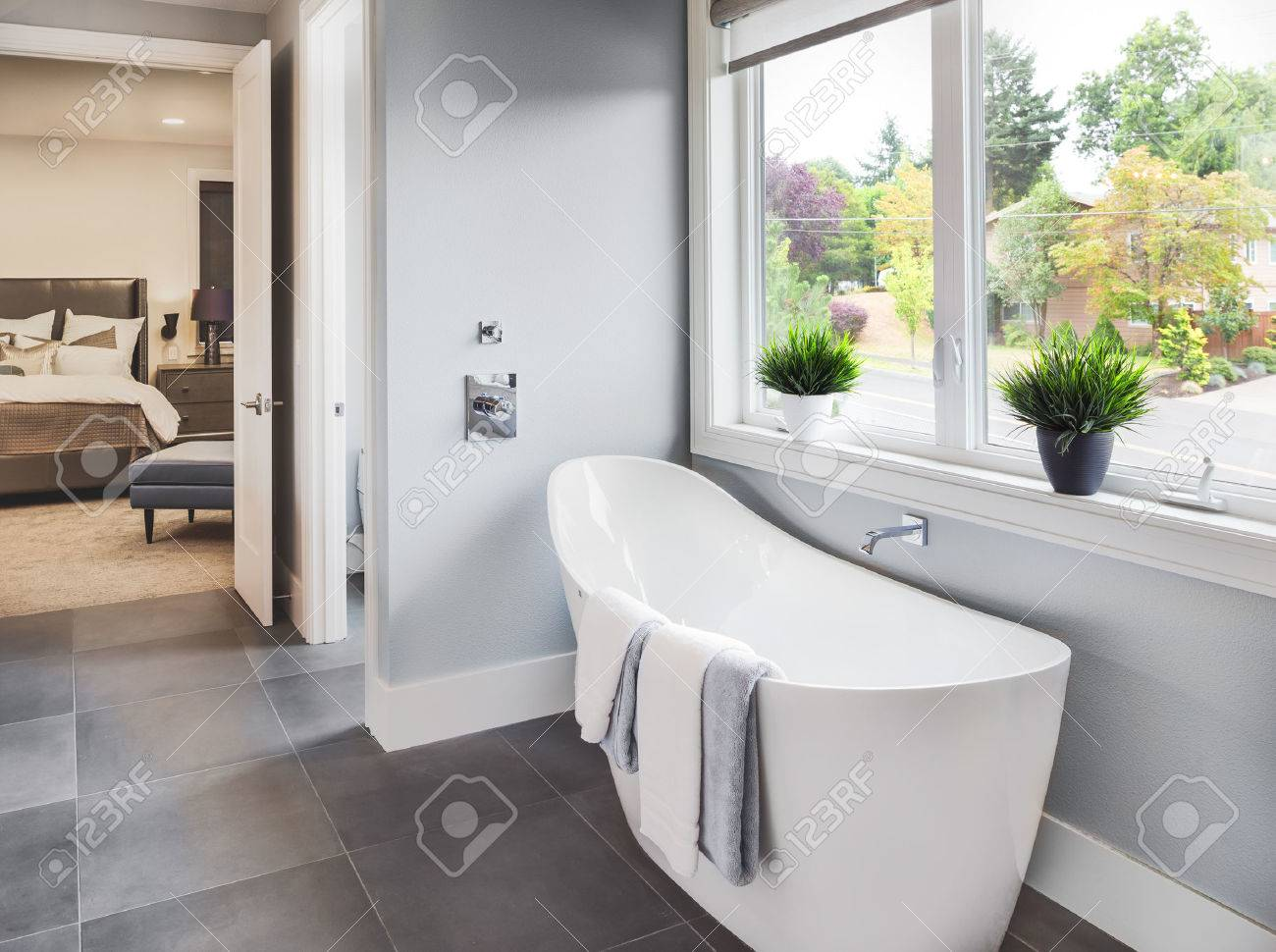 Bathtub In Master Bathroom In New Luxury Home With View Of Master Bedroom  And Neighborhood With
