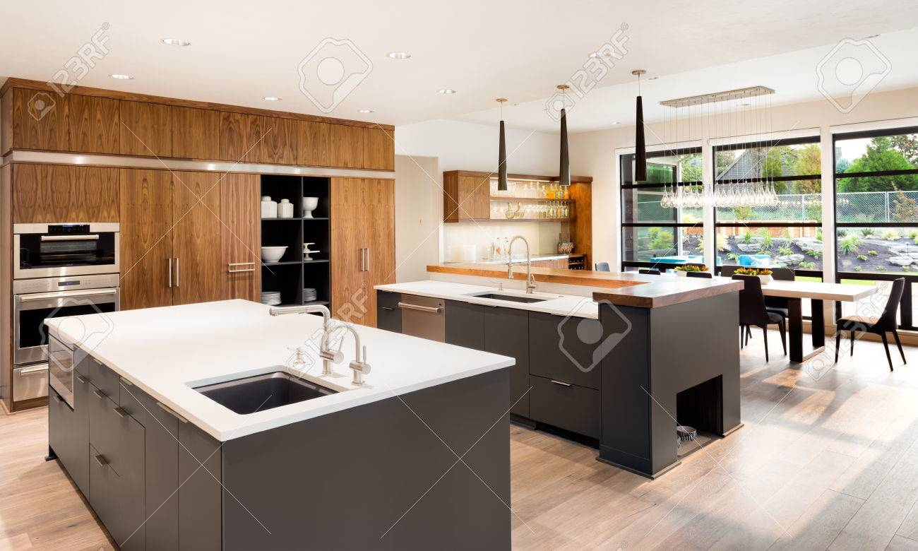 Kitchen Interior with Two Islands, Two Sinks, Cabinets, and..