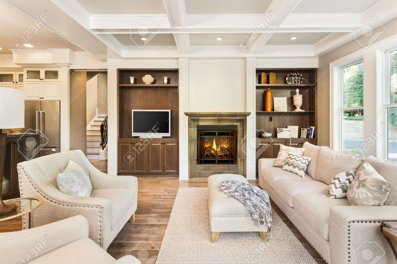 living room interior with hardwood floors in new luxury home stock