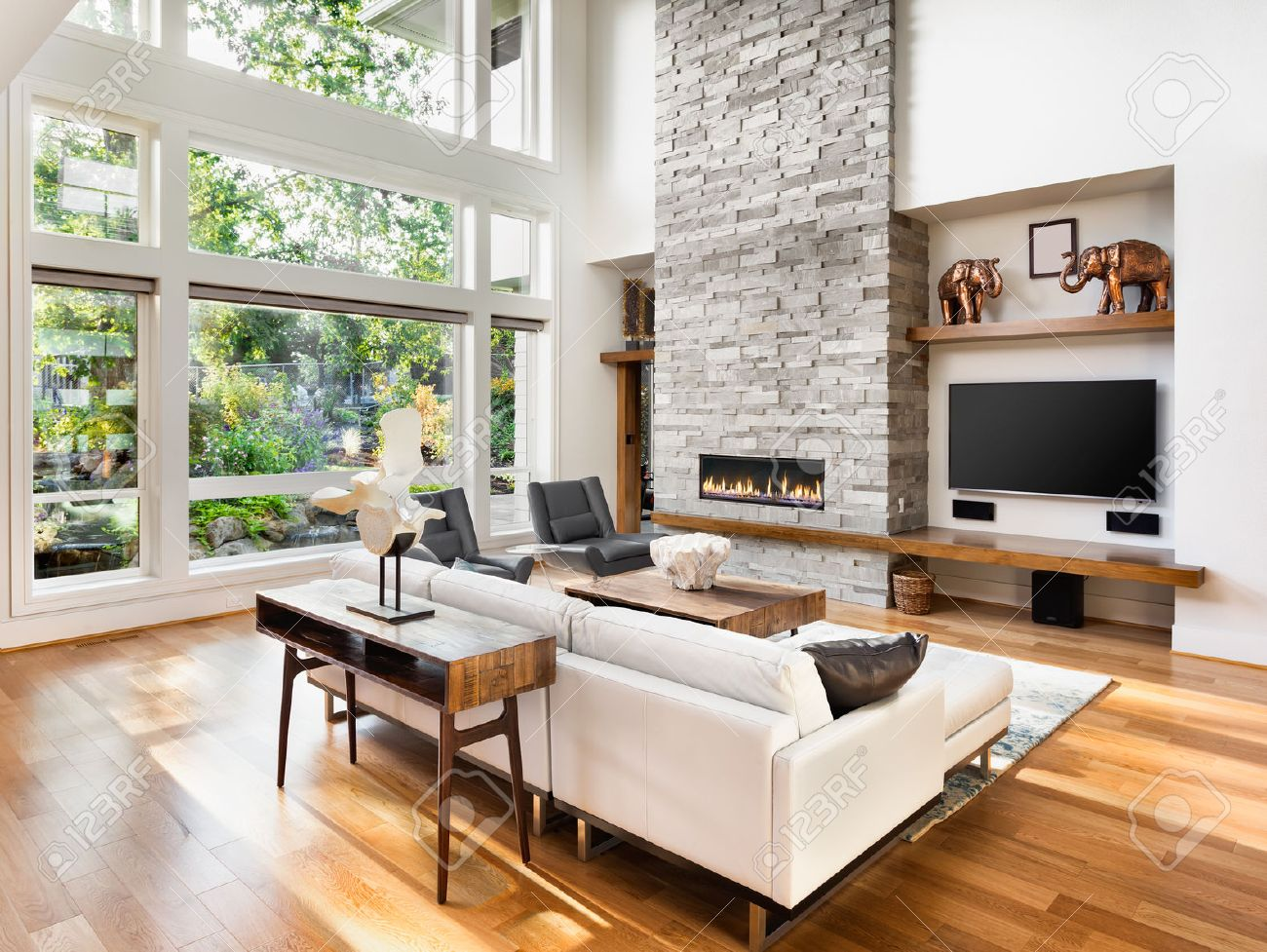 Living Room Interior With Hardwood Floors And Fireplace In New Luxury Home Stock