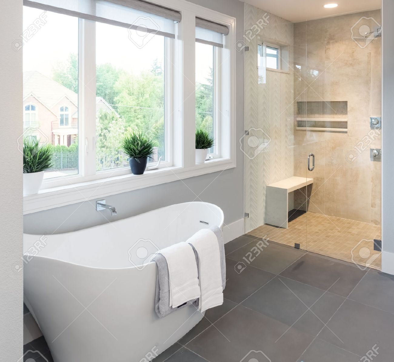 Bathroom interior bathtub and shower in new luxury home stock photo 47256762