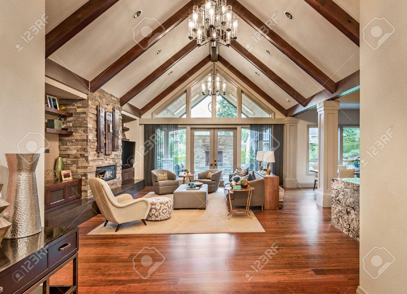 beautiful living room with hardwood floors tv and fireplace