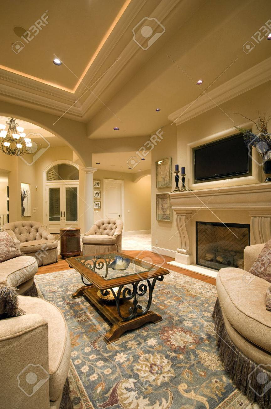 Living Room Interior in New Luxury Home with Fireplace, Rug,..