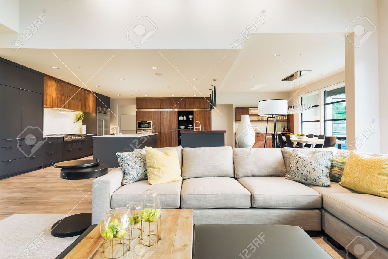 Has High Vaulted Ceilings Beautiful Living Room Interior In New Luxury Home With View Of Kitchen