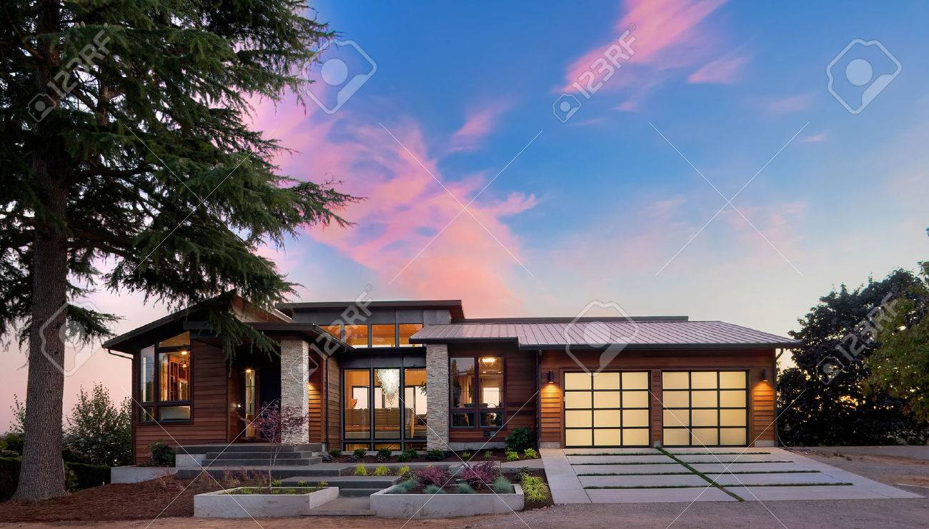 home exterior of luxury house at sunset with colorful sky stock photo 54676651