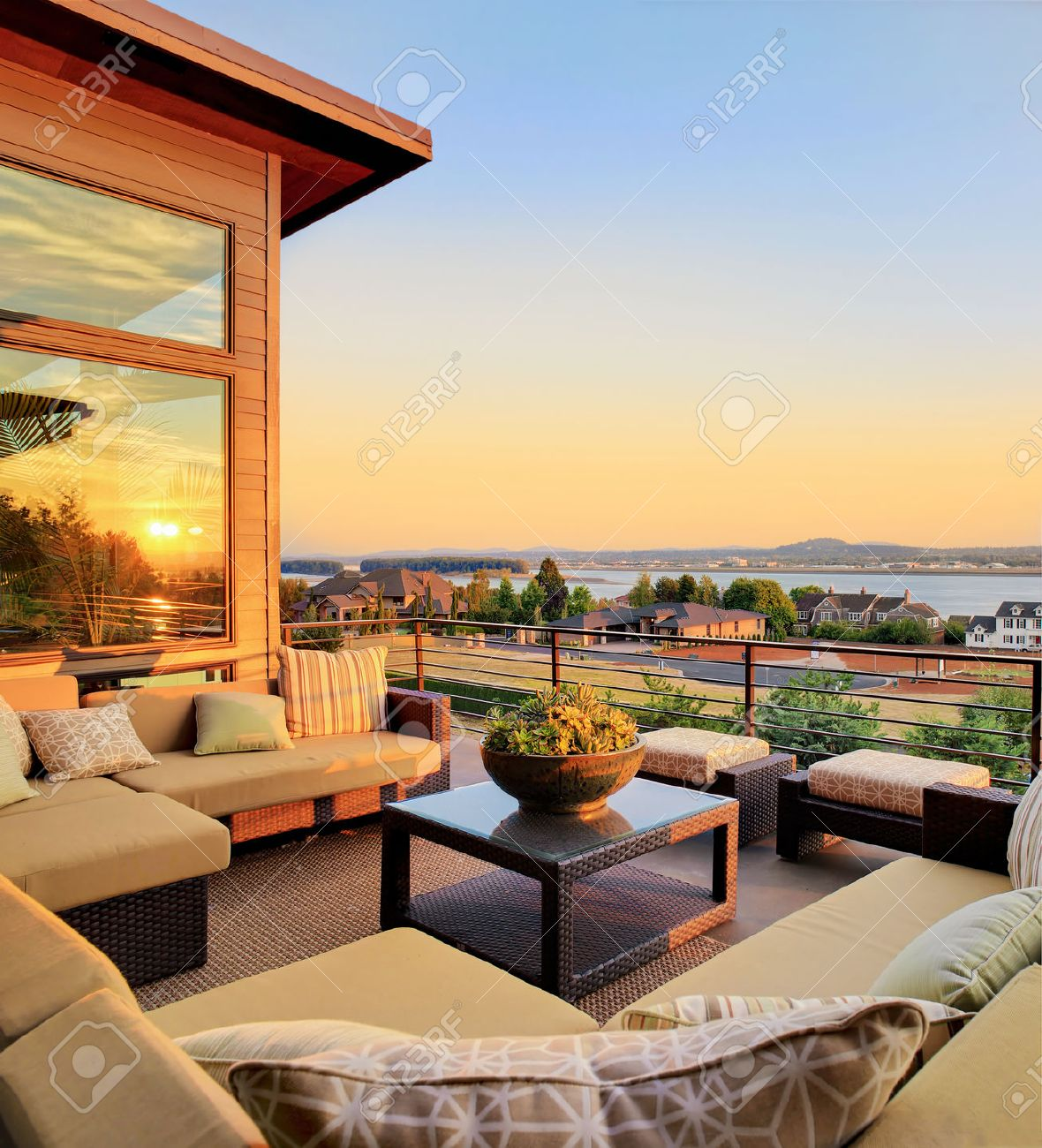 Patio Outside Luxury Home With Beautiful Sunset View Of City Stock