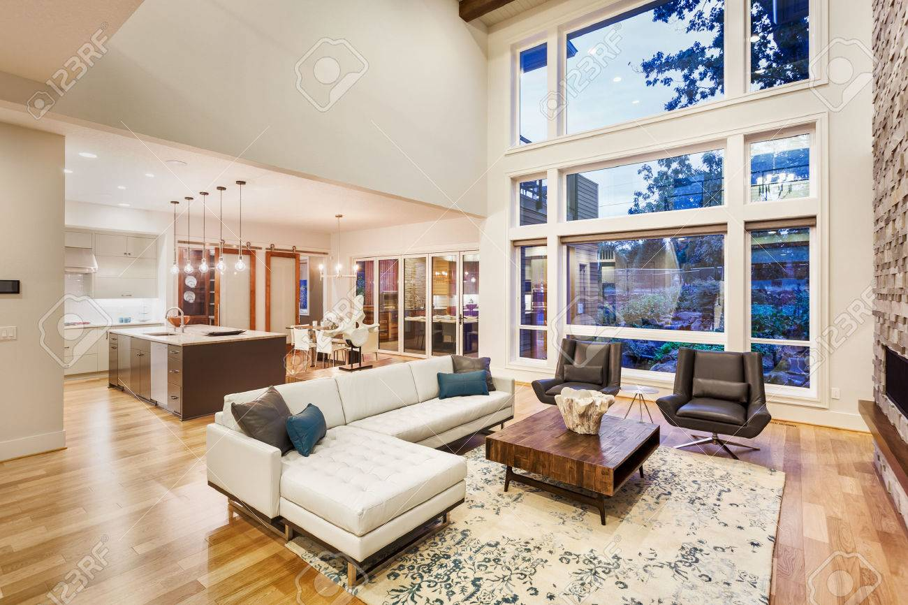 Large Living Room With Vaulted Ceilings In New Luxury Home, With Large Bank  Of Windows