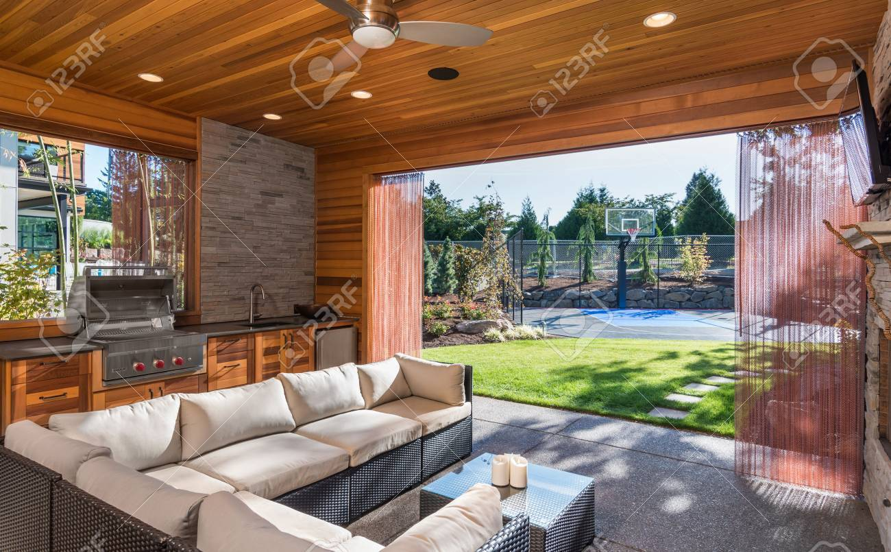 Beautiful Covered Patio With Barbecue And View Of Landscaped Yard And  Basketball Court As Part Of