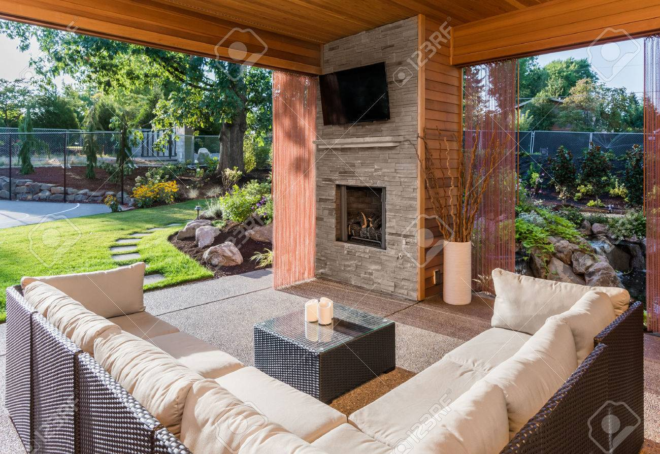 beautiful covered patio with fireplace television and view