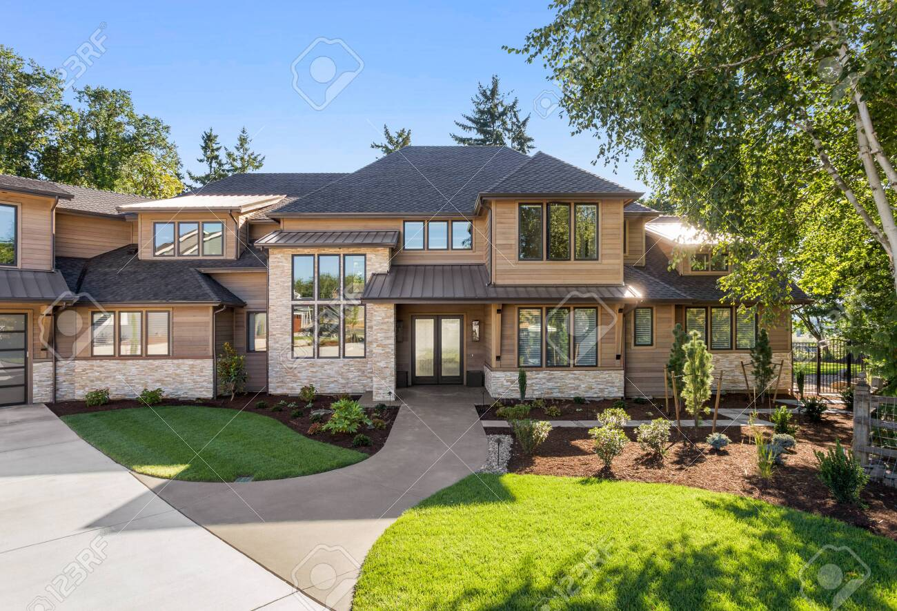 Luxury Home Exterior On Sunny Day With Blue Sky Features Three Stock Photo Picture And Royalty Free Image Image 138689023