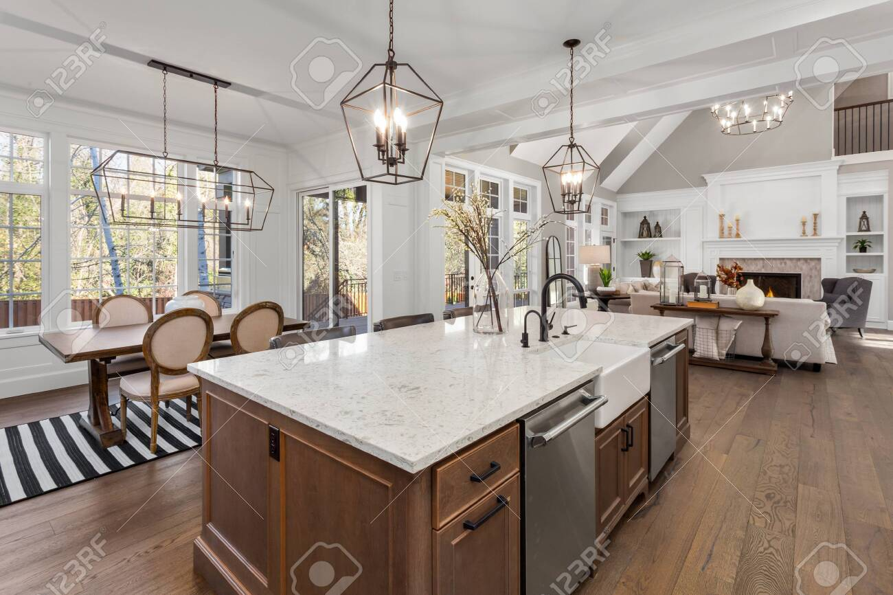 Beautiful kitchen in new traditional style luxury home, with quartz counters, hardwood floors, and stainless steel appliances - 138767796