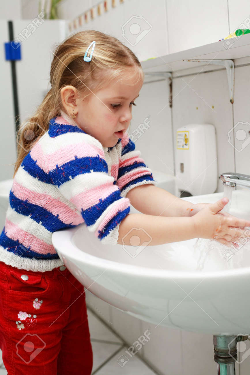 Small girl washing her hands in the bathroom Stock Photo - 3055079