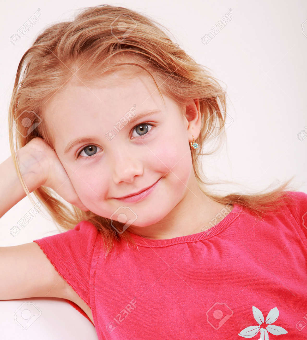 Beautiful small girl is smiling  sincerely Stock Photo - 5147671