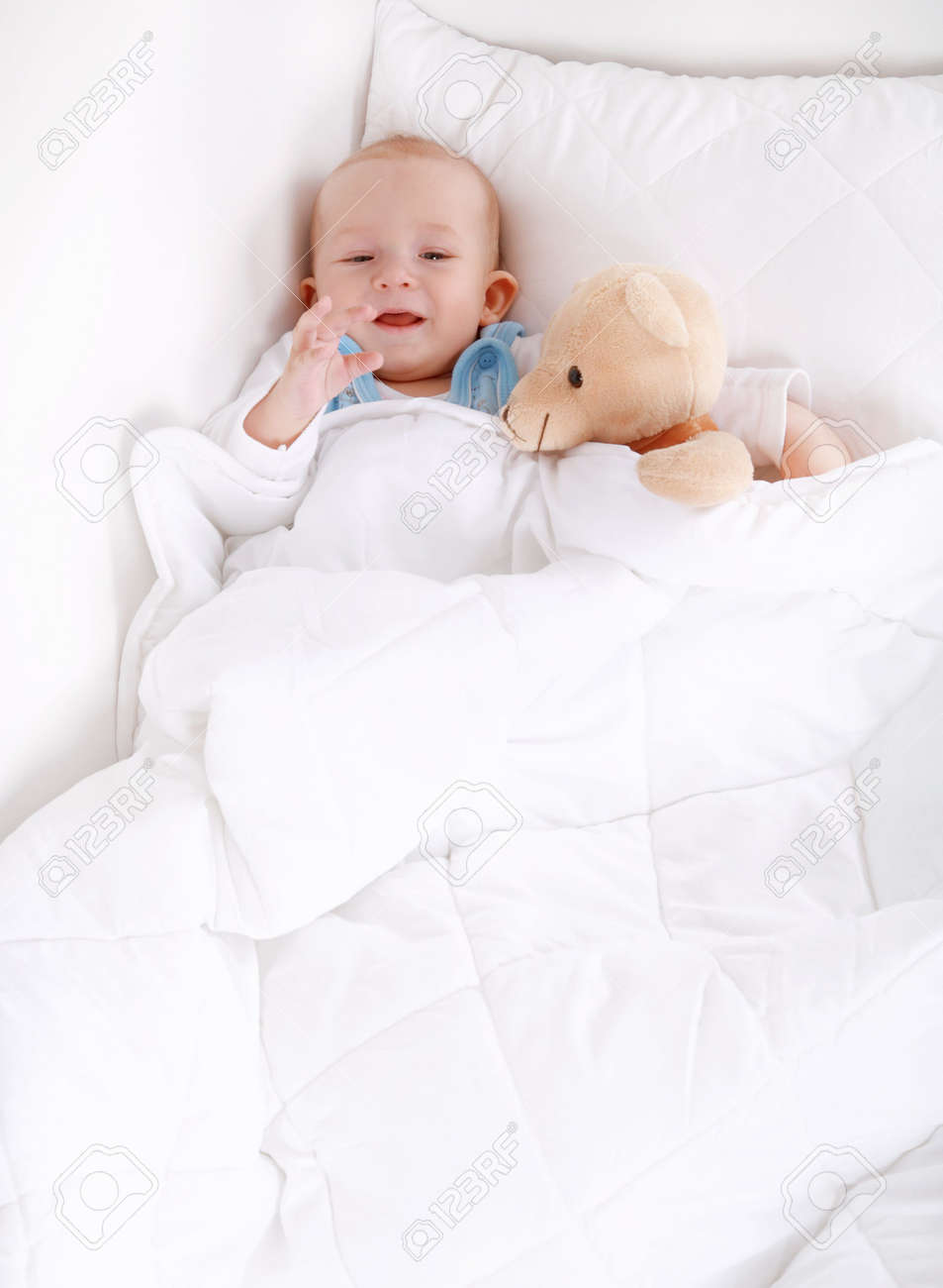 Portrait of cute cute little baby with teddy Stock Photo - 6825970
