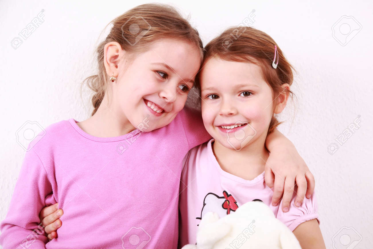 Happy girlfriends smiling and holding each other Stock Photo - 6952736