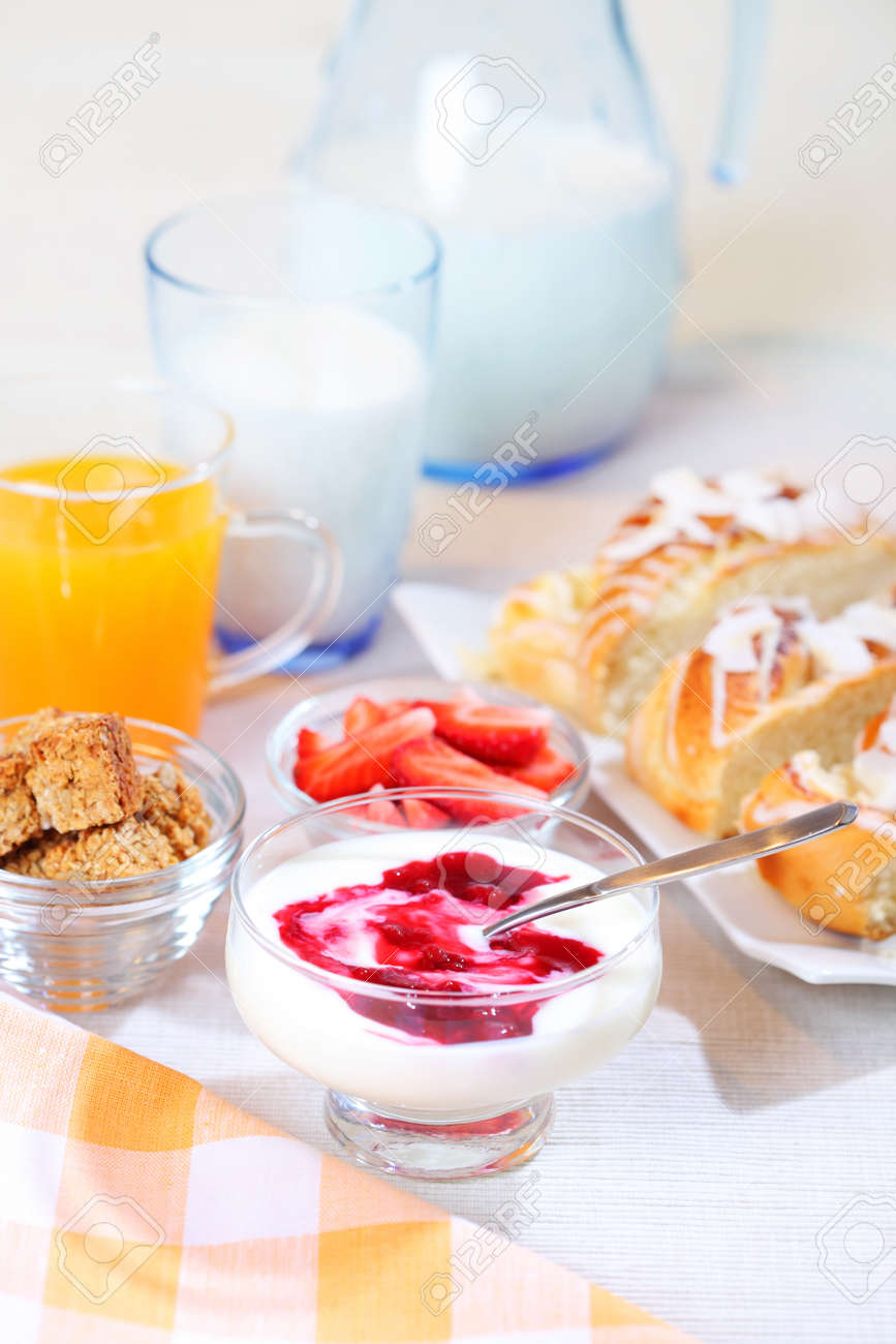 Healthy breakfast or snack with yogurt, pound cake and fresh fruits Stock Photo - 7023843