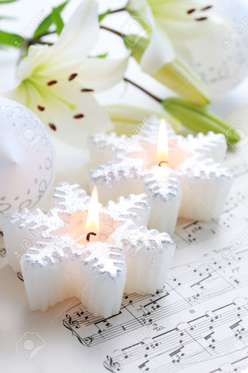 Christmas still life with candles and music notes Stock Photo - 7929514