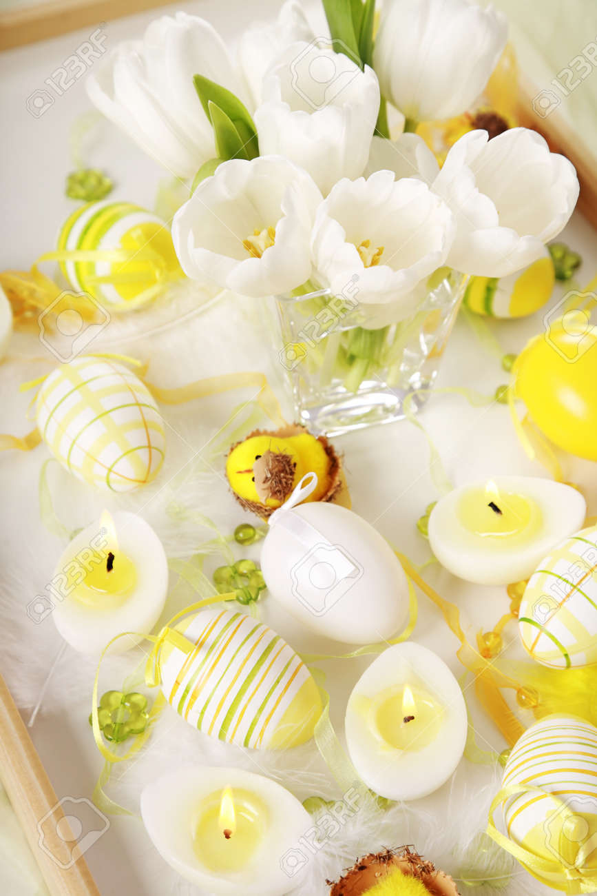 Table decoration for Easter with eggs and white tulips Stock Photo - 8750717