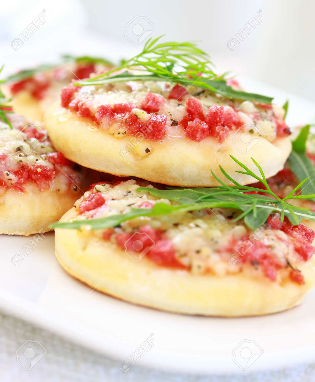 Small cakes with ham and cheese as appetizer Stock Photo - 9864917