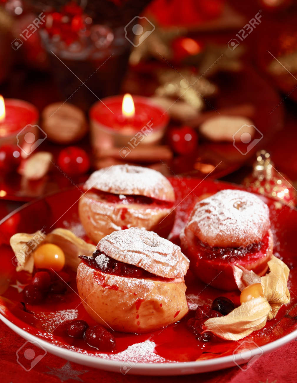 Delicious baked apple with cranberry stuffing for Christmas Stock Photo - 9864948