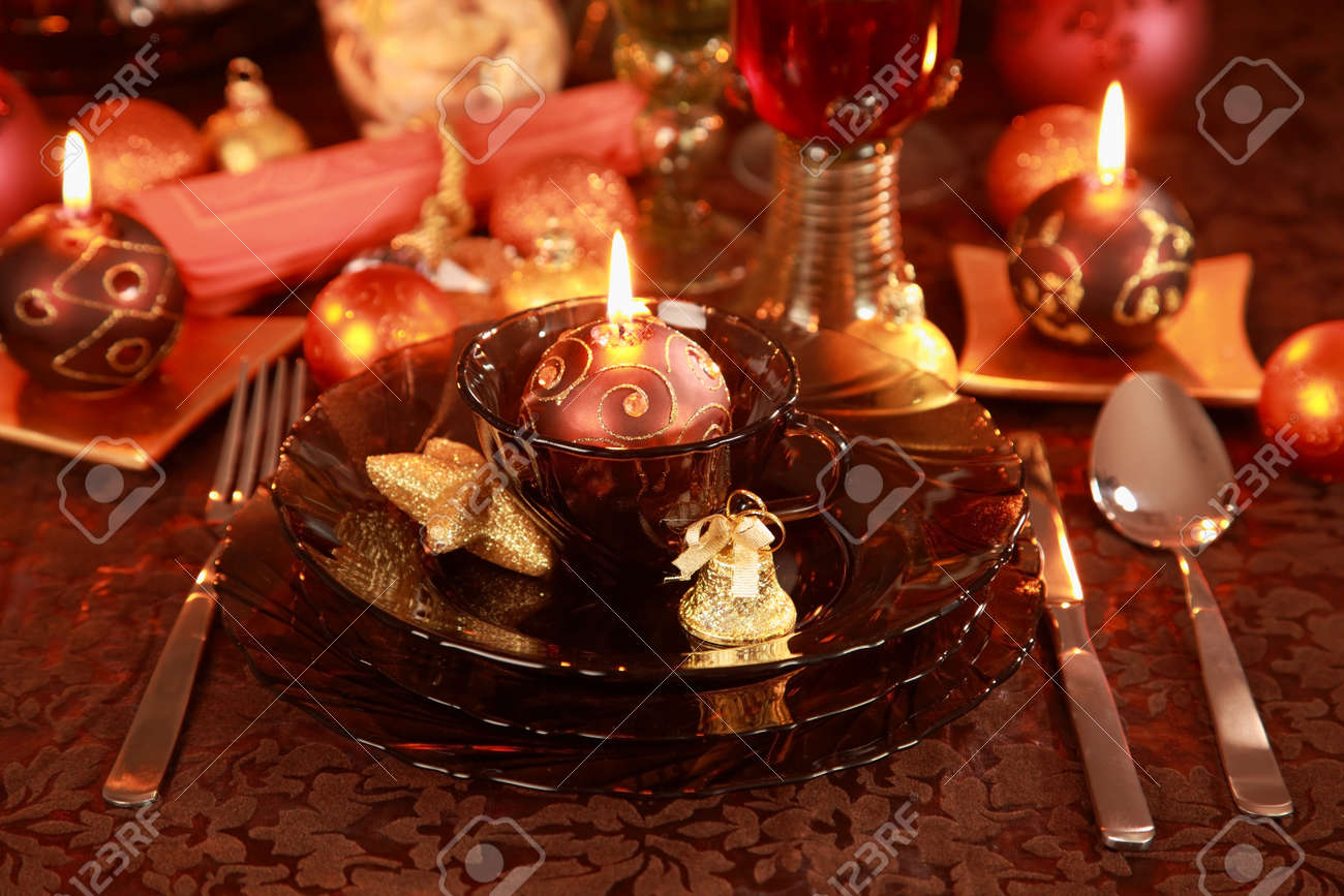 Luxury place setting in golden and brown  for Christmas Stock Photo - 10020667