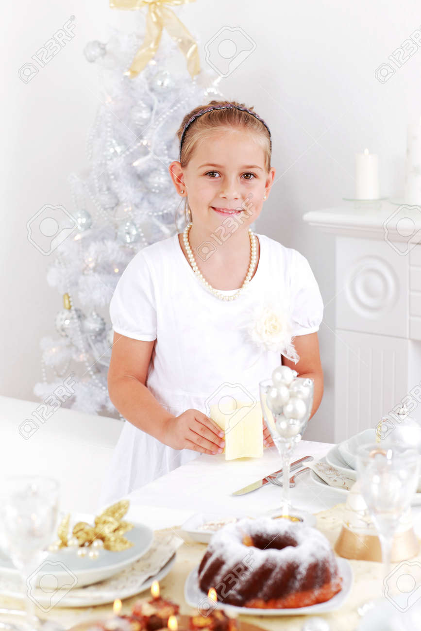 Cute girl setting table for Christmas Stock Photo - 10846962
