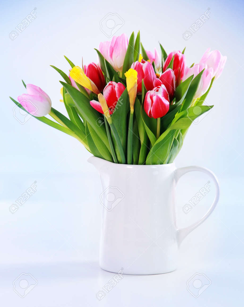 Home appliance - beautiful spring flowers in vase on the table Stock Photo - 12659232