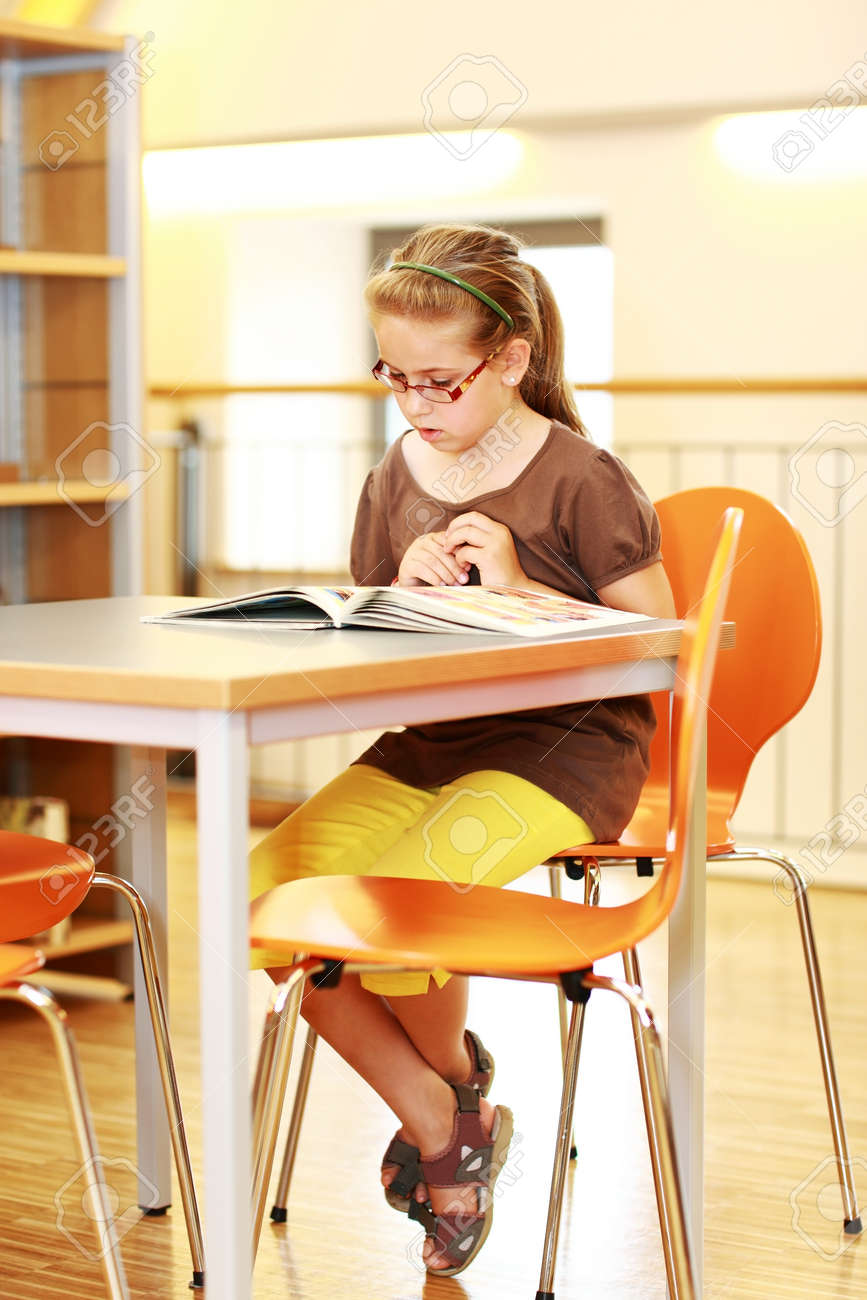 School girl studying in library Stock Photo - 14160333