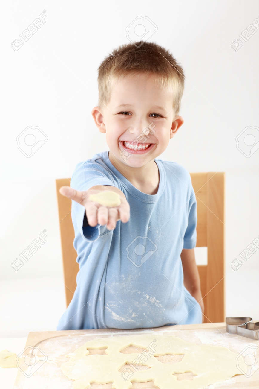 Lovely boy baking cookies for Christmas Stock Photo - 14304799