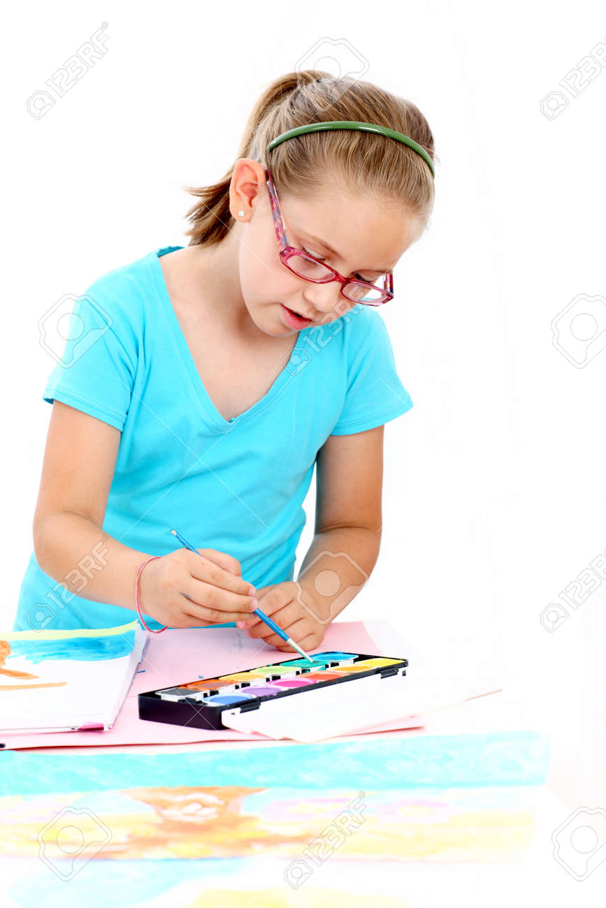 Schoolgirl painting with watercolor Stock Photo - 14390128
