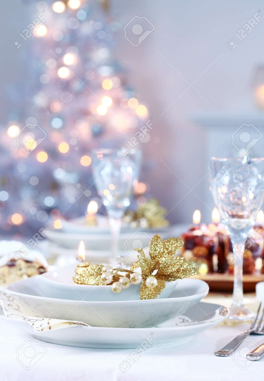 Dinner Table Background place setting with christmas tree in background stock photo