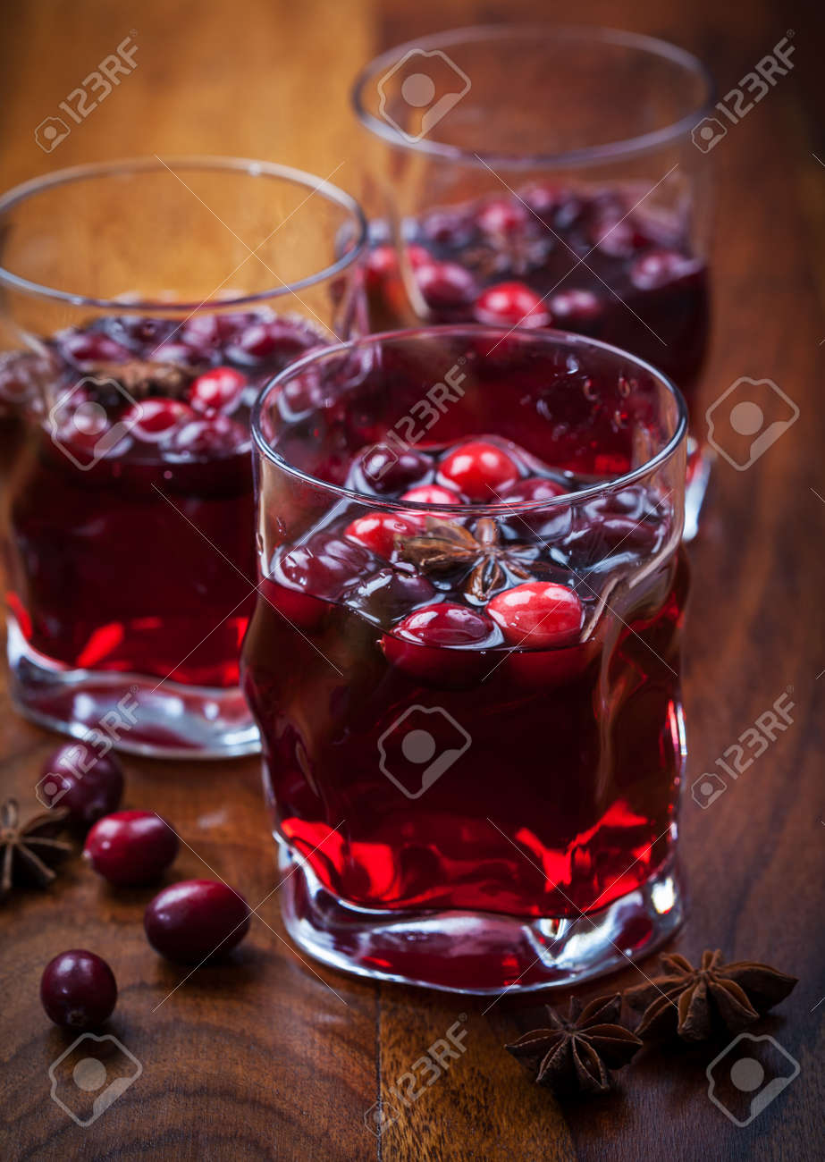 Hot drink with cranberries for Christmas on wooden table Stock Photo - 16726456