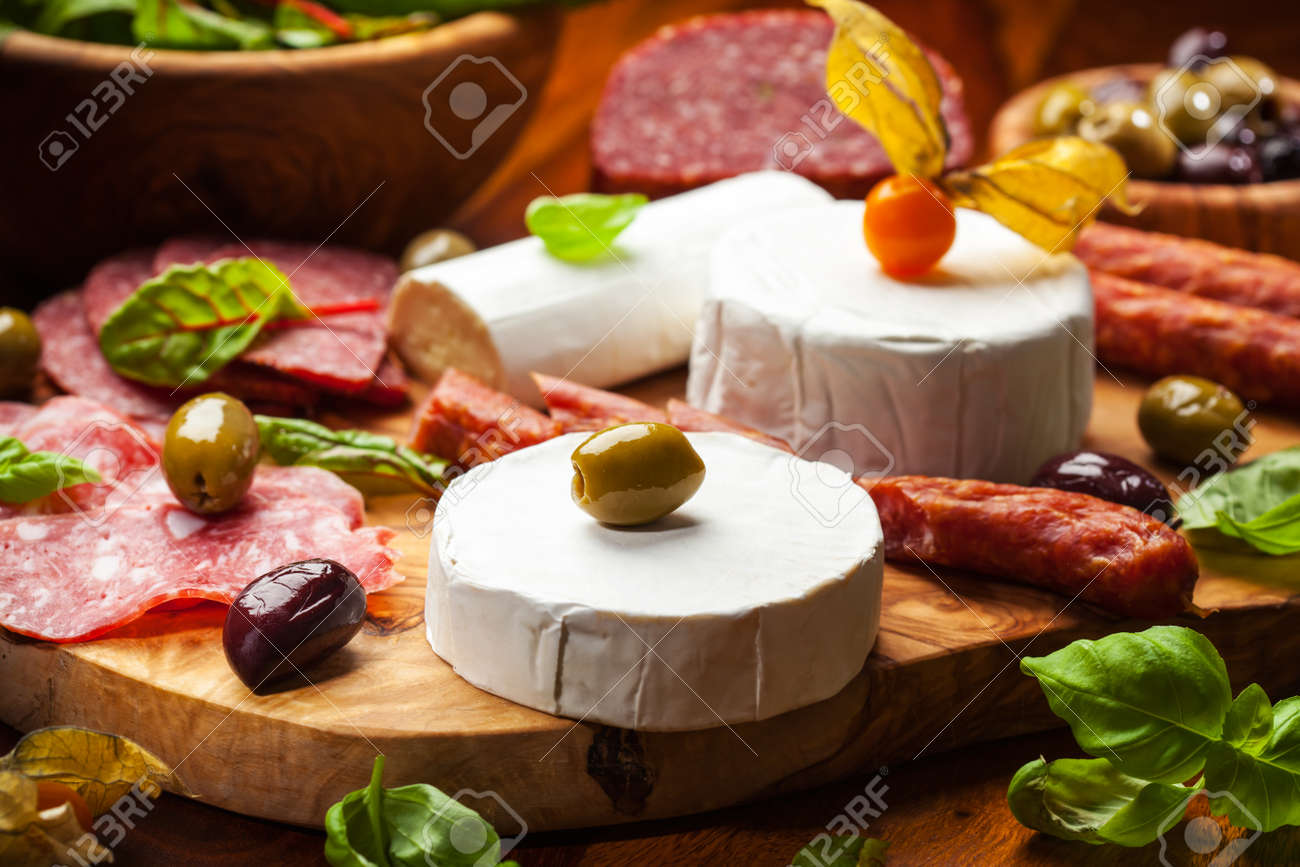 Antipasto catering platter with different meat and cheese products Stock Photo - 17305531
