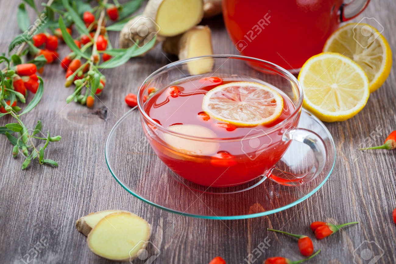 Tea With Fresh Goji Berries And Ginger Stock Photo Picture And
