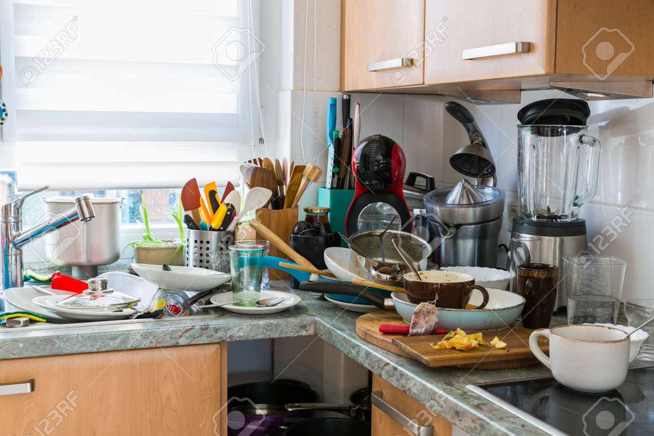 Compulsive Hoarding Syndrom - messy kitchen with pile of dirty dishes - 120570946