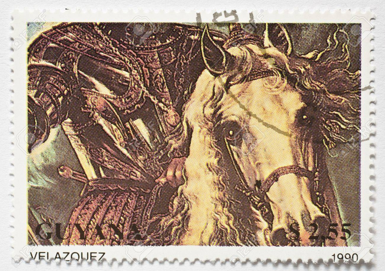 GUYANA - CIRCA 1990  a stamp from Guyana shows a Velazquez painting of a horseman in armour, circa 1990 Stock Photo - 17564340