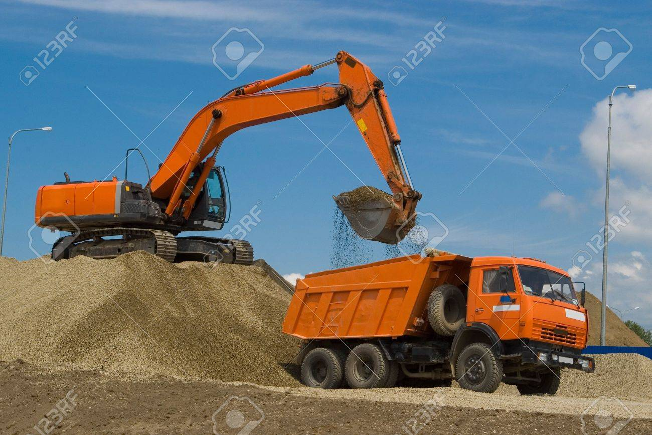 excavator and dump truck at the building site stock photo picture