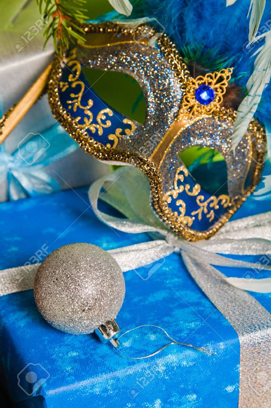 New Year's and Christmas ornaments and a carnival a mask Stock Photo - 8348336