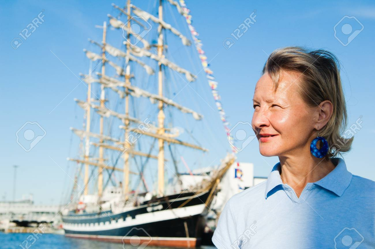 The woman on a background of a sailing vessel Stock Photo - 10048375