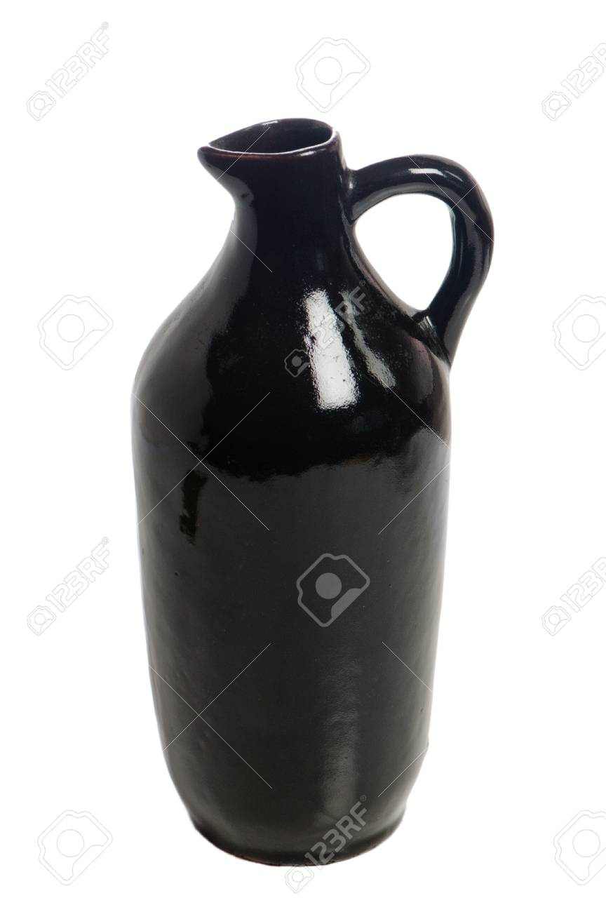 Black jug for wine, it is isolated on white Stock Photo - 13024360
